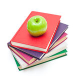 Apple on stack of books Stock Image