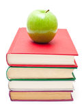 Apple on stack of books Royalty Free Stock Photos