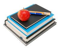 Apple on a stack of books Royalty Free Stock Image