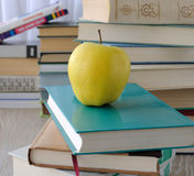 Apple on stack of books Royalty Free Stock Image