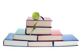 Apple on stack of books royalty free stock images