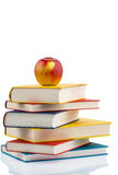 Apple on a stack of books Royalty Free Stock Photos