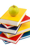 Apple on a stack of books Royalty Free Stock Images