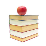 Apple and a stack of books on white background Royalty Free Stock Image
