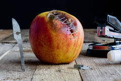 Apple with stapler Royalty Free Stock Images