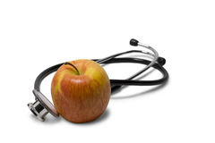 Apple with a stethoscope Royalty Free Stock Photo