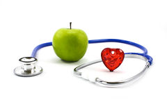 Apple and stethoscope Stock Photos