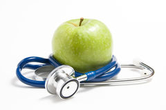 Apple with stethoscope Royalty Free Stock Photos