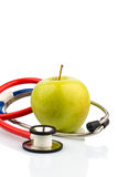 Apple and stethoscope Stock Image