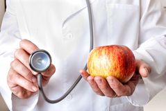 Apple or Stethoscope Stock Photos