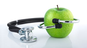 Apple and stethoscope - healthy diet Stock Photo