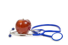 Apple And Stethoscope Stock Images