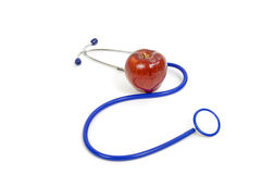 Apple With Stethoscope Royalty Free Stock Photo