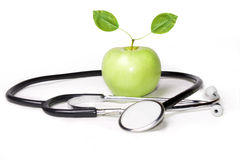 Apple and stethoscope Royalty Free Stock Photography