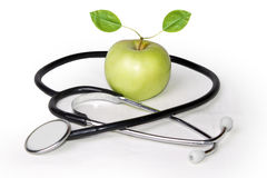 Apple and stethoscope Stock Photo