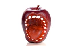 Apple With Sticking Out Tongue Toy Royalty Free Stock Photos
