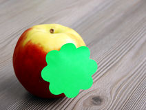 Apple and sticky note Royalty Free Stock Photo