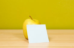 Apple with sticky note Royalty Free Stock Image