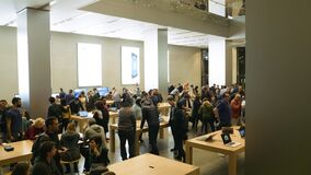 Apple Store Barcelona with customers admiring diverse gadgets