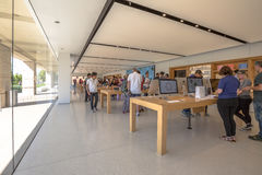 Apple Store Cupertino. Cupertino, CA, USA - August 15, 2016: people inside the Apple store of Apple Inc HQ at One Infinite Loop. Apple is a multinational Stock Image