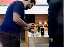 Apple Store Genius selling first iphone in France Stock Images