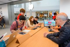 Apple store. HONG KONG - DECEMBER 25, 2015:  interior of Apple store. Apple Inc. is an American multinational technology company headquartered in Cupertino Stock Images