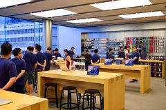 Apple store. HONG KONG - MAY 5, 2015:  interior of Apple store. Apple Inc. is an American multinational technology company headquartered in Cupertino, California Stock Photo