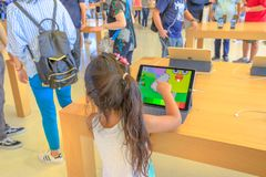 Apple Store kids app. Cupertino,CA,United States - August 12, 2018: Child playing a kids app on Ipad in the new Apple store and Headquarters of Apple Park royalty free stock image