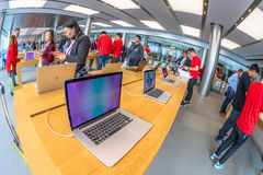 Apple Store laptop. Hong Kong, China - December 4, 2016: close up mac book laptop inside Apple store, IFC Mall, Central District. Apple is world leader in stock image