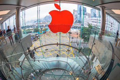 Apple Store logo. Hong Kong, China - December 4, 2016: fish-eye wide view of Red Apple sign and modern spiral staircase in Apple store, IFC Mall, with Royalty Free Stock Photography