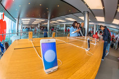 Apple Store mobile. Hong Kong, China - December 4, 2016: close up mobile smath phone inside Apple store, IFC Mall, Central District. Apple is world leader in royalty free stock photography