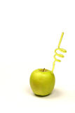 Apple with a straw. Fresh apple drink with straw on a white background Stock Photography