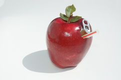 Apple and straw. Apple with poptop stock photography
