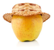 Apple with straw hat. Isolated on white Royalty Free Stock Photos
