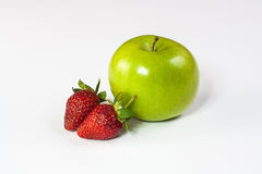 Apple and Strawberry. Fresh apple and straberry combined with white background royalty free stock photo