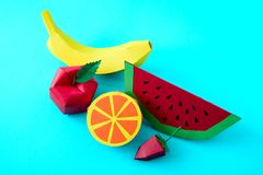 Apple, strawberry, banana, orange and watermelon made from paper on blue background. Fresh fruits. Minimal, creative, vegan,. Healthy or food art concept. Copy royalty free stock photography