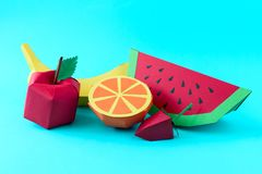Apple, strawberry, banana, orange and watermelon made from paper on blue background. Fresh fruits. Minimal, creative, vegan,. Healthy or food art concept. Copy royalty free stock photo