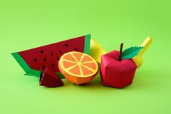 Apple, strawberry, banana, orange and watermelon made from paper on green background. Fresh fruits. Minimal, creative, vegan,. Healthy or food art concept. Copy stock image