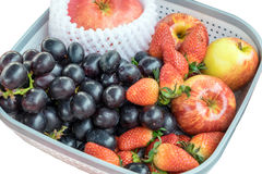Apple strawberry and black grape in tray Royalty Free Stock Photos