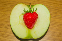 An apple strawberry hearted Royalty Free Stock Image