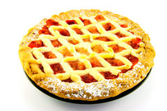 Apple and Strawberry Pie. Whole apple and strawberry pie on a black plate on a white background Stock Photography