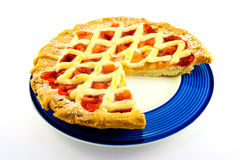 Apple and Strawberry Pie with a Slice Missing. Whole apple and strawberry pie on a blue plate with a slice missing on a white background Stock Photo