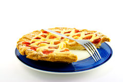 Apple and Strawberry Pie with a Slice Missing. Whole apple and strawberry pie with a small fork on a blue plate with a slice missing on a white background Stock Photography