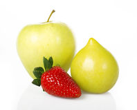 Apple, strawberry and plum. On white background royalty free stock images