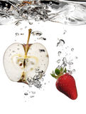 Apple and strawberry in water. Isolated on white background royalty free stock photos