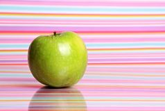 Apple on stripy background Stock Images