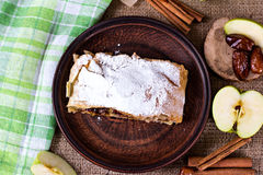 Apple strudel or apple pie. With dates and cinnamon Royalty Free Stock Photos