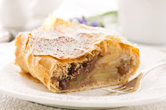 Apple Strudel. As closeup on a white plate Stock Images