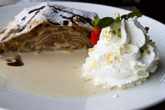 Apple strudel with cream Royalty Free Stock Image