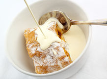 Apple Strudel with cream poured Royalty Free Stock Images